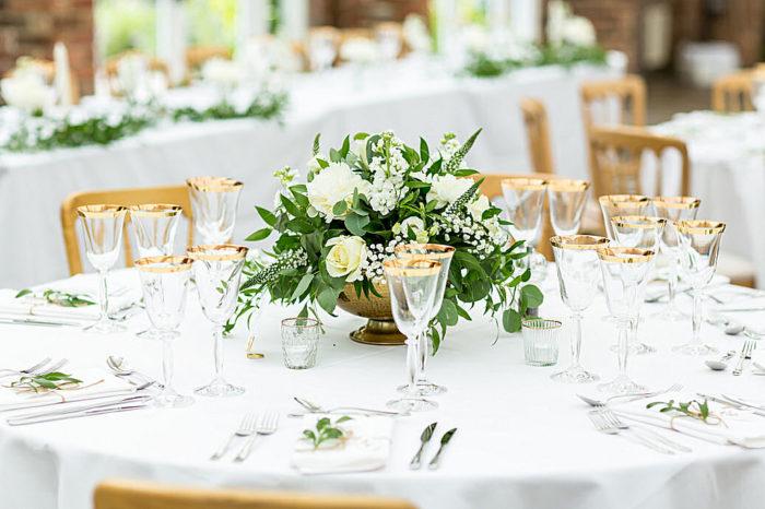 "<img alt=""Moutan Flowers wedding table arrangement"">"
