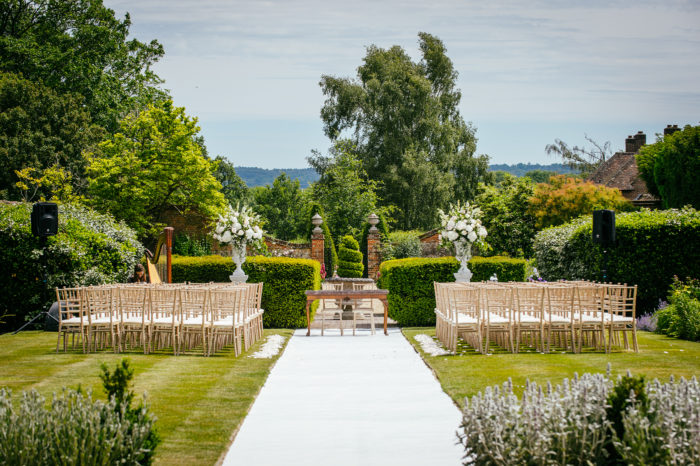 Walled garden at Four Seasons Hampshire decorated with Moutan flower arrangements